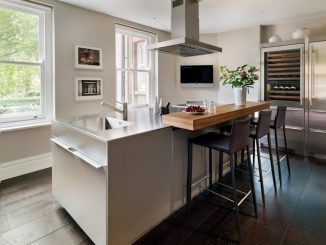 Minimalist Kitchen With Tables And Bar Chairs.jpg