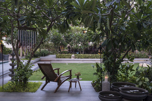 Ideas for how to design a porch and landscaped garden for a tropical villa