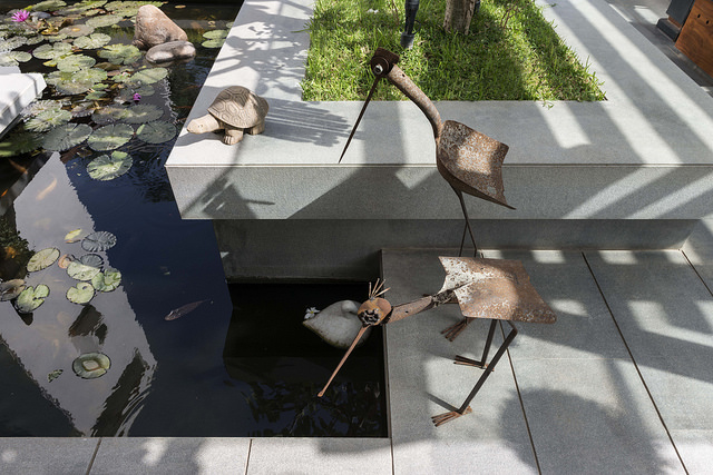 Various animal sculptures around the water bodies in landscape of this tropical bungalow