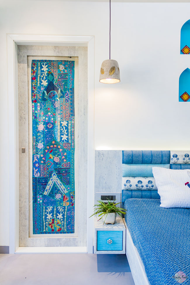 Rann of Kutch inspired bedroom in predominantly blue colour with niches.