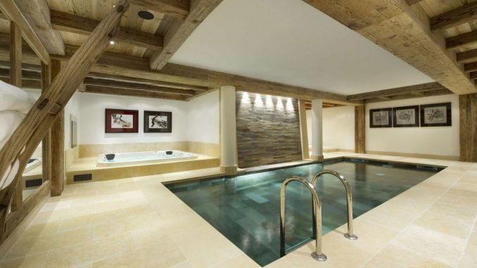Simple Designed Small Pool Designs Installed Inside House With Wooden Ad Concrete Ceiling Combined With Tiled Flooring Nuanced In Cream.jpg