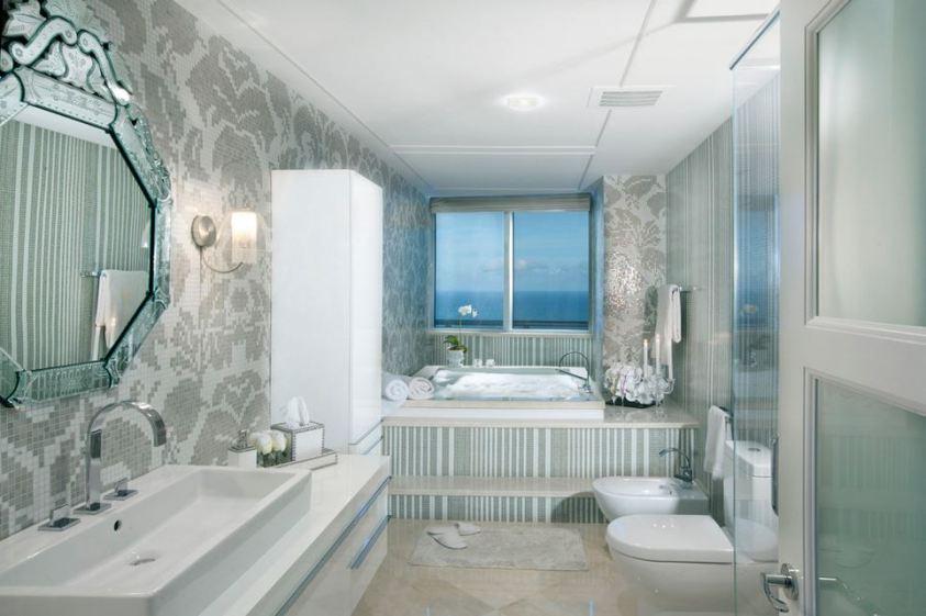 modern bathroom with mosaic tiles and a bidet
